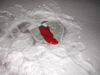 A Christmas stocking is left at Comiskey Park I home plate for Buck Weaver.