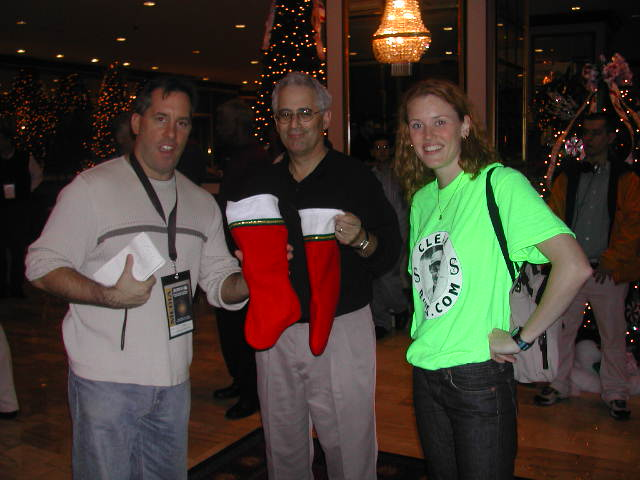 Amber hands out Christmas stockings filled with ClearBuck merchandise at the 2003 MLB meetings.