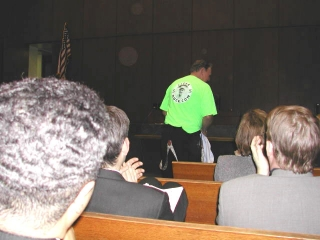 Joel Daly as Buck Weaver's lawyer Clarence Darrow, reveals the ClearBuck t-shirt at the 2003 Lincoln Chicago Inn of Court Jackson/Weaver retrial.