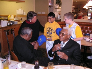 Negro Leaguers and Little Leagues with Chicago Baseball Museum VP Linda Williamson.