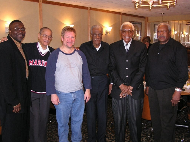 Negro League players and Negro League proprietors stand with Dr. David Fletcher.