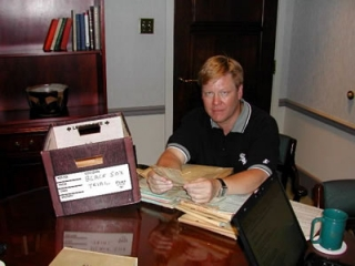 Dr. Fletcher reviews files from the Jackson vs. Comiskey Milwaukee trial.