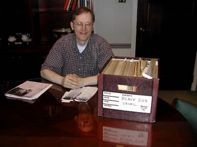 Atty. Tom Cannon looks through files from the Jackson vs. Comiskey Milwaukee trial.